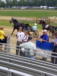 Fair King and Queen start the harness race