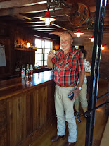 Dick samples some whisky at Red Eagle Distillery