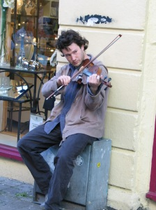 Street musician in picturesque Galway, Ireland