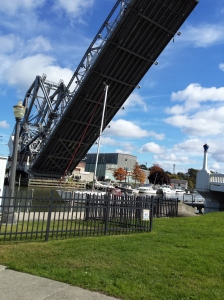 Can you spot the mast of the sail boat right under the lift bridge?