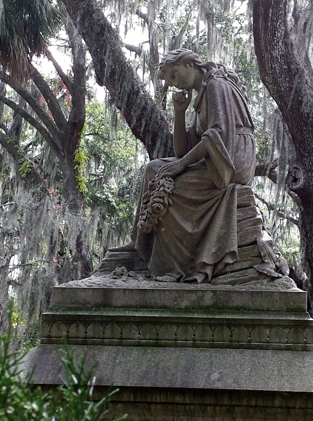 Mourning angels, Confederate soldiers' memorials, and memorials to loved ones across the years lie under the live oaks draped with Spanish moss on the bank of the river.