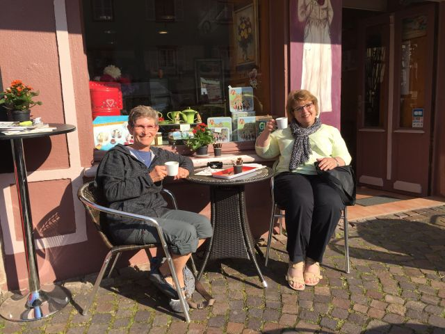 My friend Sue and I are at our favorite cafe in Ribeauville, having our morning coffee.